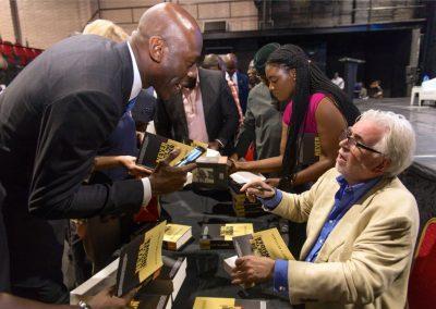 Signing with Amaechi Okobi